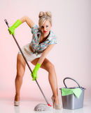girl retro style, woman housewife cleaner with mop stock images