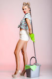 Sexy girl retro style, woman housewife cleaner with mop. Full length sexy girl retro style with mop, woman housewife cleaner in domestic role. Traditional Royalty Free Stock Photos