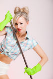 Sexy girl retro style, woman housewife cleaner with mop Royalty Free Stock Image