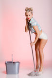 Sexy girl retro style, woman housewife cleaner with mop. Full length sexy girl retro style with mop, woman housewife cleaner in domestic role. Traditional Stock Images