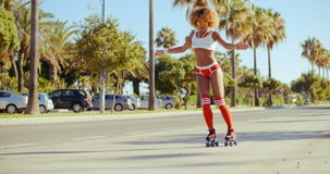 Sexy Girl Riding on Roller Skates stock video footage
