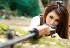 Sexy girl with rifle. Thai sexy girl use the sniper rifle Royalty Free Stock Photos