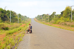 girl on the road with her motorbike traveling laos stock image