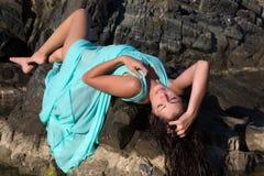 Sexy girl on the rocks Royalty Free Stock Photos