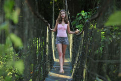 Sexy girl on the rope bridge Stock Photo
