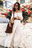 girl with rose in dark curly hair and elegant white outfit, stock photos