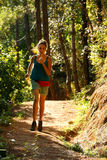 Sexy girl running along narrow footpath in forest Royalty Free Stock Photography