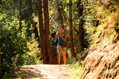 Sexy girl running along narrow footpath in forest Stock Images