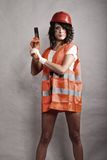Sexy girl in safety helmet holding hammer tool Royalty Free Stock Photography