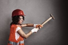Sexy girl in safety helmet holding hammer tool Stock Photo