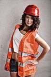 Sexy girl in safety helmet and orange vest Royalty Free Stock Photo