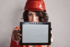Sexy girl in safety helmet showing tablet Royalty Free Stock Image