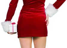 Sexy girl in santa outfit holding gift Royalty Free Stock Photos