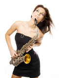 Sexy girl with saxophone Stock Images