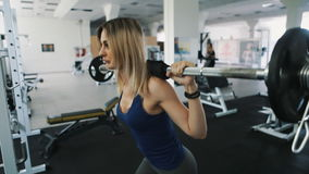 Sexy girl with sexy body doing barbell workout routine in gym, healthy lifestyle stock video footage