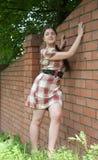 Sexy girl in  short  dress. Near brick wall Stock Image