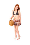 Sexy girl in short skirt and bra. With a basket in  her hands Royalty Free Stock Photography