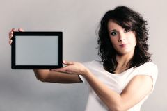 girl showing copy space on tablet touchpad Stock Images