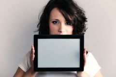 girl showing copy space on tablet touchpad Royalty Free Stock Images