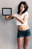 girl showing copy space on tablet touchpad Royalty Free Stock Photo