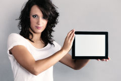 Sexy girl showing copy space on tablet touchpad Stock Images