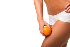 Sexy girl shows cellulite and orange Royalty Free Stock Photography