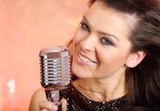 Sexy Girl singing in retro mi Stock Photography
