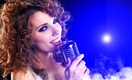 Girl singing in retro mic Royalty Free Stock Images