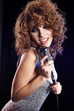Sexy Girl singing in retro mic Stock Photos