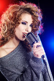Sexy Girl singing in retro mic Stock Image