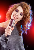 Sexy Girl singing in retro mic Royalty Free Stock Photography