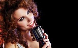 Sexy Girl singing in retro mic Royalty Free Stock Photo