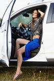 Sexy girl sitting in the car Royalty Free Stock Image