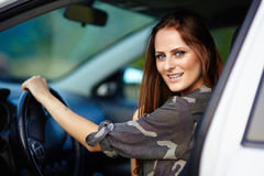 Sexy girl sitting in the car Stock Images