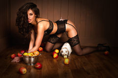 Sexy girl sitting on a floor with apple Royalty Free Stock Image