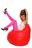 Sexy Girl Sitting In Bean Bag Stock Image