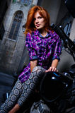 Sexy girl sitting on a motorcycle Royalty Free Stock Image