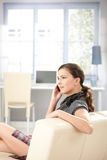 girl sitting on sofa chatting on mobile Royalty Free Stock Photo