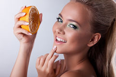 Sexy girl smile with squeeze orange Stock Photos