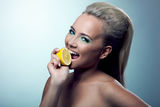Sexy girl smile and taste lemon Stock Photography