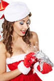 Sexy girl smiles and holding a gift Stock Photography