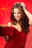 Sexy girl smiles and holding a  gift in box Royalty Free Stock Image