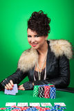 Sexy girl smiles at poker table Stock Photography