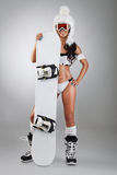 Girl with snowboard. Girl standing with snowboard royalty free stock photography
