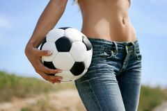 Sexy girl with soccer ball Stock Images