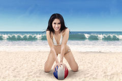 Sexy girl with a soccer ball at beach Stock Image