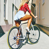 Sexy girl on a sport style bicycle Royalty Free Stock Photos