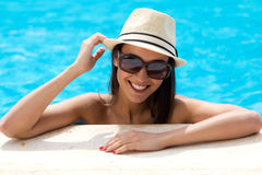 Sexy girl standing in swimming pool. Royalty Free Stock Photo