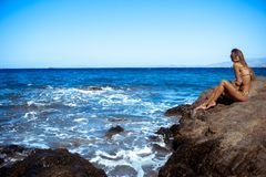 Girl in a stunning blue sea. Woman in a stunning blue sea stock images