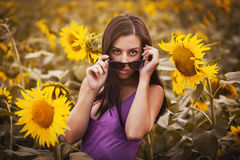 Sexy girl in a sunflower's field Royalty Free Stock Images